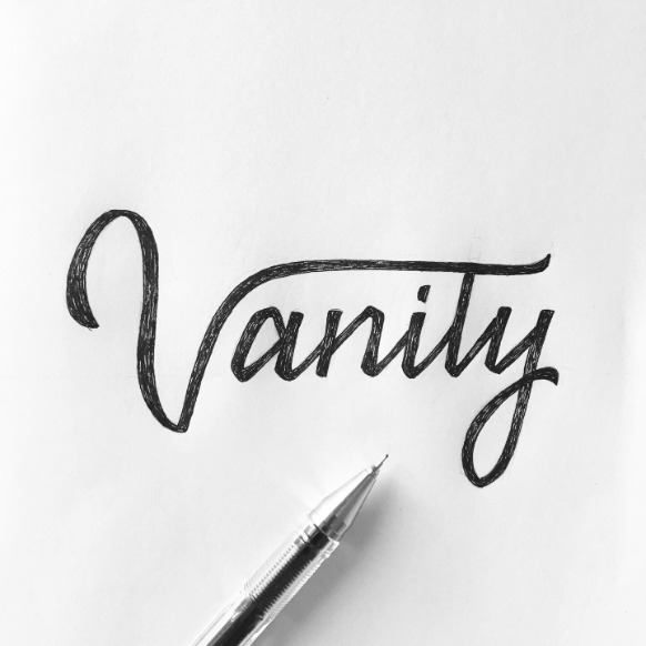 """Vanity"" modern lettering in a sketchbook"